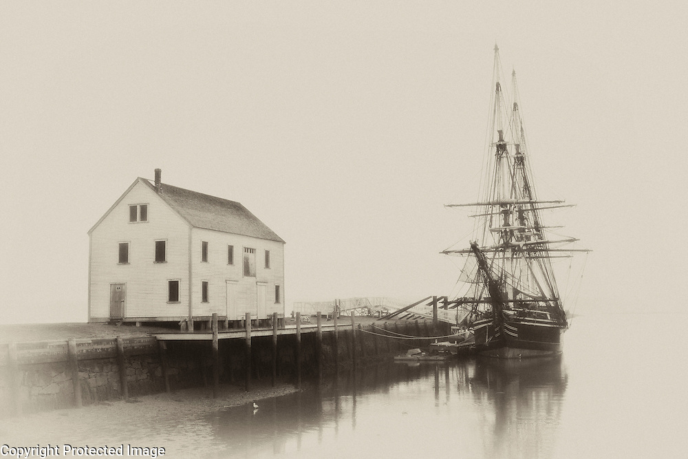 The sailing ship, period home, and foggy atmosphere bespeak of mariners and the life of seagoing men.