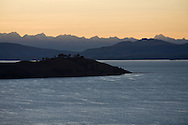 Sunrise behind the Cordillera Real on Lake Titicaca, Bolivia, as seen from the Island of the Sun.