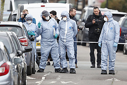 © Licensed to London News Pictures. 03/04/2018. London, UK. Police forensics officers at the scene in Chalgrove Road, Tottenham, north London where a 17 year old girl was shot dead. The girl was found with a bullet wound and pronounced dead at the scene at 21:43 last night. Police were also called to another shooting and stabbing incident in Walthamstow. Photo credit: Peter Macdiarmid/LNP
