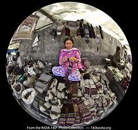 Woman Knitting Himalayan Yak Wool Socks in the Leh district of Ladakh India