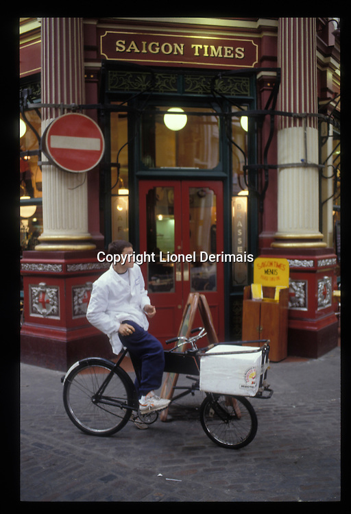 Delivery boy has a smoke in Leadenhall market, London.