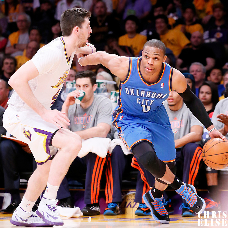 09 March 2014: Oklahoma City Thunder point guard Russell Westbrook (0) drives past Los Angeles Lakers power forward Ryan Kelly (4) during the Los Angeles Lakers 114-110 victory over the Oklahoma City Thunder at the Staples Center, Los Angeles, California, USA.