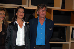 PRINCESS CAROLINE OF MONACO and hr husband PRINCE ERNST OF HANOVER at an exhibition of work by Rolf Sachs - a unique world-renowned contemporary furniture designer, held in association with the Louisa Guinness Gallery and held at 250 Brompron Road, London on 6th October 2004.<br /><br />NON EXCLUSIVE - WORLD RIGHTS