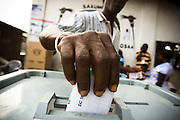 A man casts his ballot during presidential elections in Accra, Ghana on Sunday December 28, 2008. Voters were back at the polls to decide on a new leader after none of the candidates was able to obtain a 50 percent plus one vote majority during the election's first round on Dec 7.