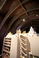 Inside Casa Mila, designed by Antoni Gaudi, are a series of displays showing his various designs. Barcelona, Spain