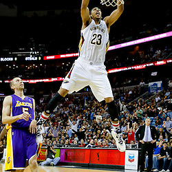 Nov 8, 2013; New Orleans, LA, USA;  New Orleans Pelicans power forward Anthony Davis (23) dunks over Los Angeles Lakers point guard Steve Blake (5) during the fourth quarter of a game at New Orleans Arena. The Pelicans defeated the Lakers 96-85. Mandatory Credit: Derick E. Hingle-USA TODAY Sports