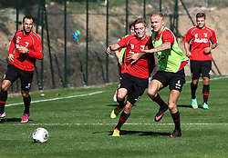 06.01.2014, Hotel Sheraton Salobre, Maspalomas, ESP, FC Augsburg Trainingslager, im Bild Laufduell Kevin Vogt (FC Augsburg #6) gegen Maik Uhde (FC Augsburg #29), <<br /> <br /> Fussball, Bundesliga, FC Augsburg, FCA, Trainingslager, Gran Canaria, Maspalomas, Saison 2013 - 2014, 05+06 01 2014,<br /> Foto: Eibner // during a practice session of the German Bundesliga Club Borussia Dortmund at their training camp at the Hotel Sheraton Salobre in Maspalomas, Spain on 2014/01/06. EXPA Pictures © 2014, PhotoCredit: EXPA/ Eibner-Pressefoto/ Krieger<br /> <br /> *****ATTENTION - OUT of GER*****