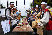 Men waiting for everyone to come and start drinking and eating at the garden of the house of Samurai Fuku Taisho during the Soma Nomaoi festival
