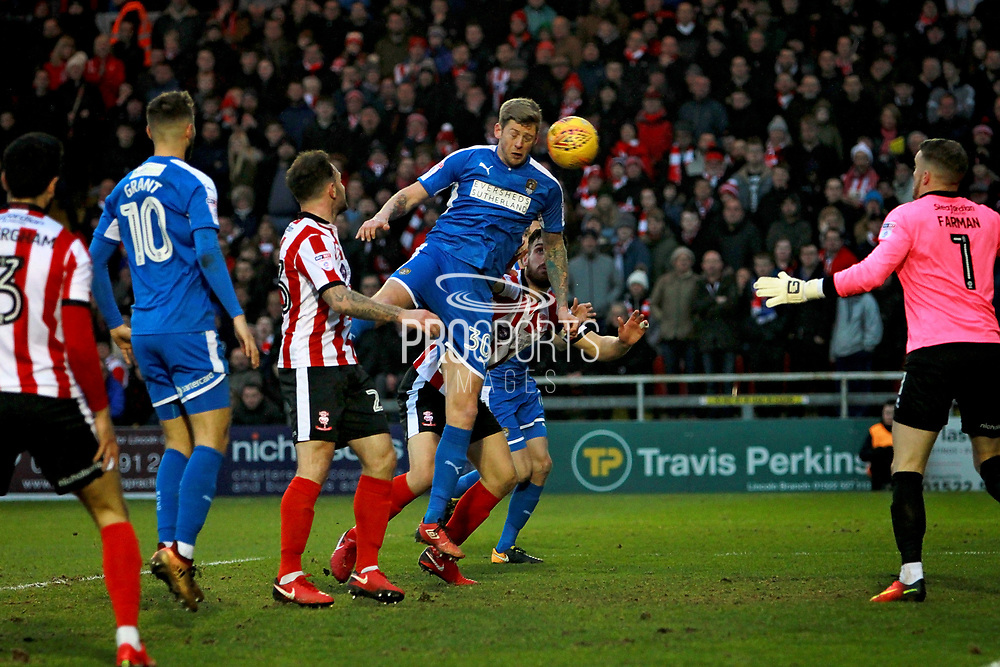 Notts County Jonathan Stead(30) nods Notts County ahead during the EFL Sky Bet League 2 match between Lincoln City and Notts County at Sincil Bank, Lincoln, United Kingdom on 13 January 2018. Photo by Nigel Cole.