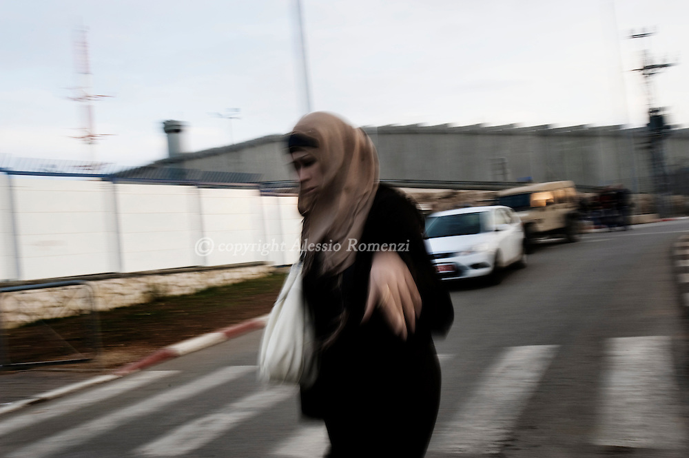 Jerusalem, Israel. A woman crosses the road close Qualandia check point, on December 09, 2009..© ALESSIO ROMENZI