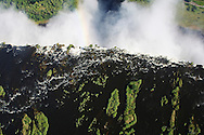 Zambezi river becomes Victoria Falls, or Mosi-oa-Tunya (Smoke that Thunders), between Zambia and Zimbabwe