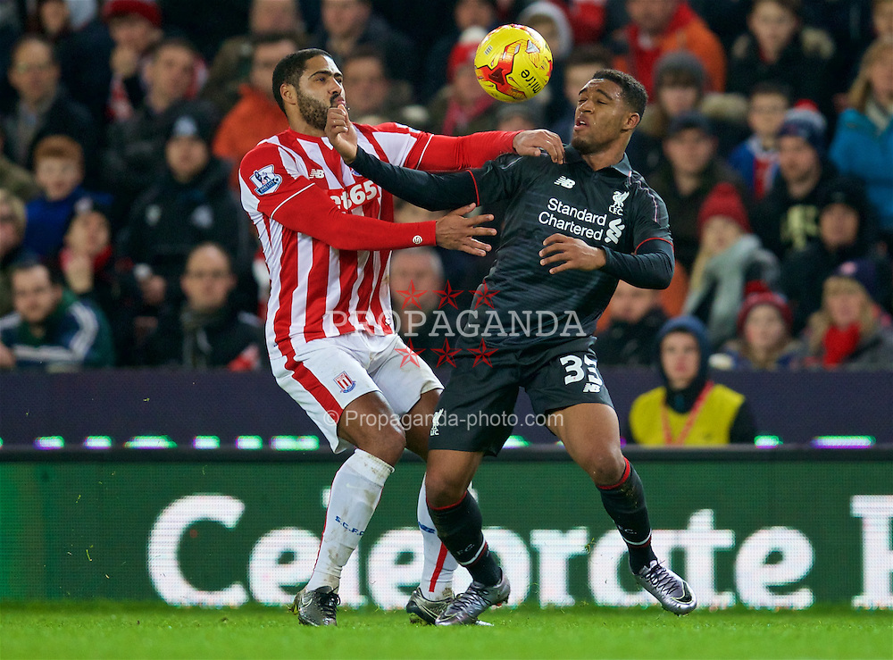 STOKE-ON-TRENT, ENGLAND - Tuesday, January 5, 2016: Liverpool's Jordon Ibe in action against Stoke City's Glen Johnson during the Football League Cup Semi-Final 1st Leg match at the Britannia Stadium. (Pic by David Rawcliffe/Propaganda)