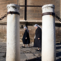 Couple of nuns walking outside Seville's cathedral, Spain