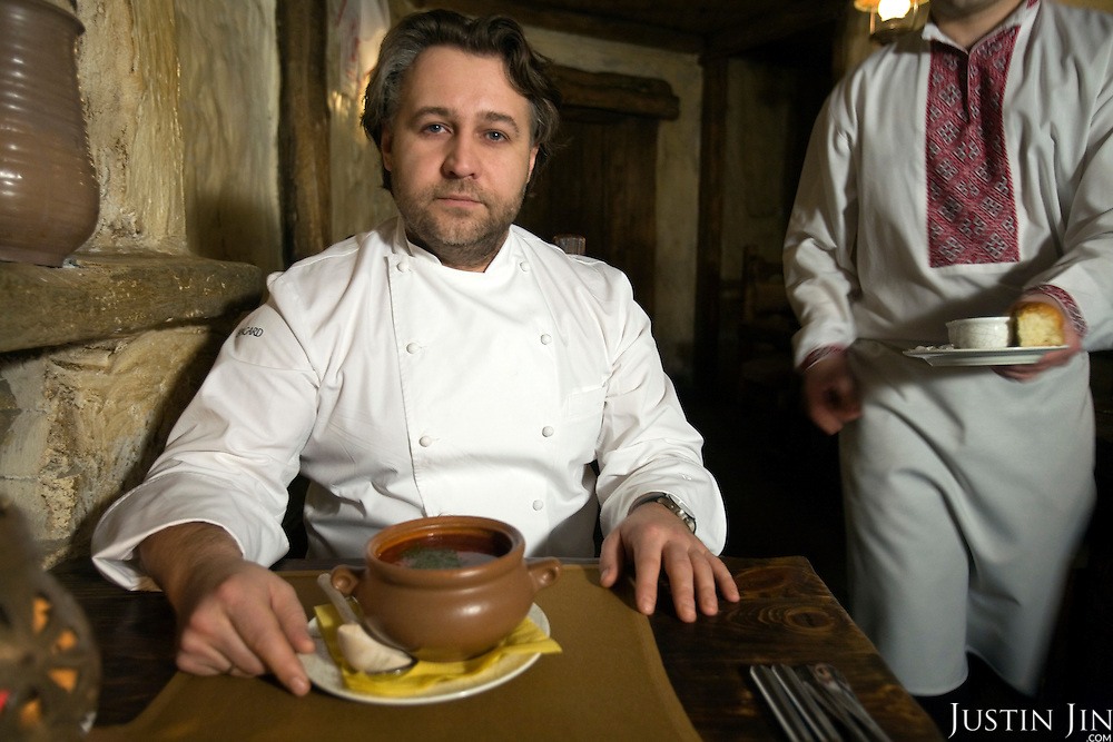 Chef Oleg Porotikov at the Shinok restaurant in Moscow. Borsht is a traditional Ukrainian cuisine that has spreaded via Russia throughout the former Soviet sphere. Shinok is created by restaurateur Andrei Dellos, who made a barn with live animals inside the restaurant.