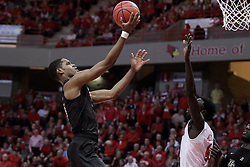 """20 March 2017:  A.J. Davis up and over Daouda """"David"""" Ndiaye (4) during a College NIT (National Invitational Tournament) 2nd round mens basketball game between the UCF (University of Central Florida) Knights and Illinois State Redbirds in  Redbird Arena, Normal IL"""