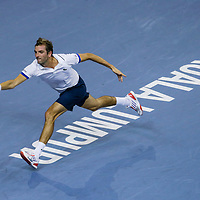 Julien Benneteau of France returns a shot during the semifinals match against Stanislas Wawrinka of Switzerland  (not pictured) at the Malaysian Open tennis tournament in Kuala Lumpur, Malaysia, 28 September 2013.
