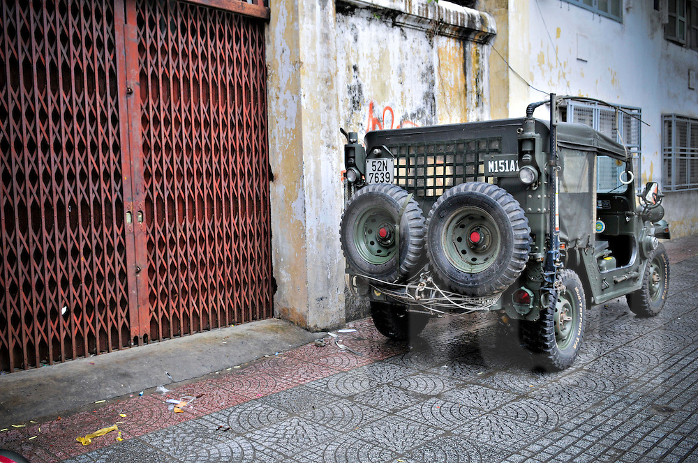 Military jeep parked in a street of Ho Chi Minh city (HCMC), Vietnam, Asia