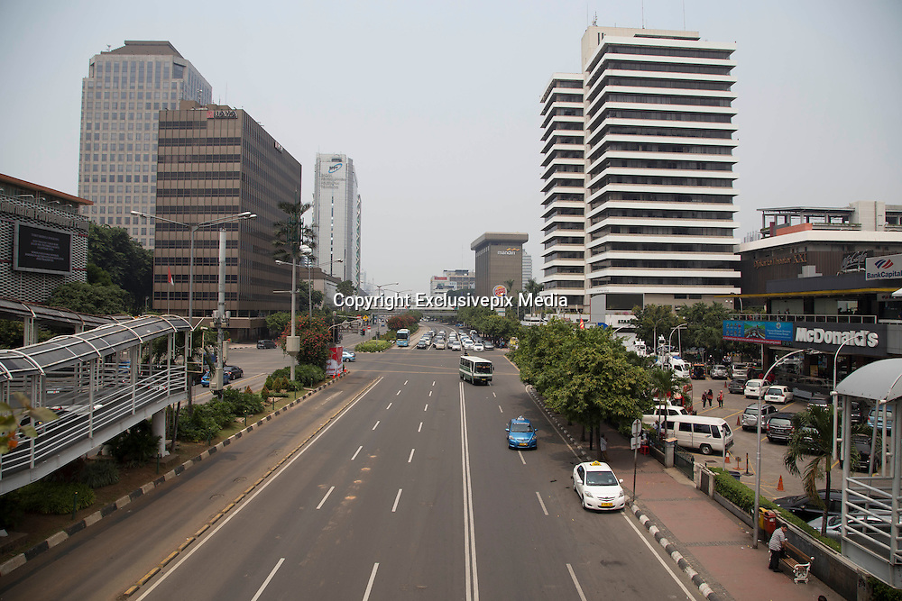 Jakarta, Indonesia 17 January 2016 : <br /> <br /> Thamrin Street Jakarta back to normal on sunday. Jakarta back to normal again after the fatal attack at Starbuck Coffee at Thamrin Street. Peoples still visiting to the bombing site to take photos and condemn to the terrorist action.<br /> ©Exclusivepix Media