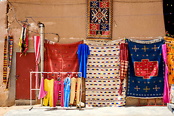 Carpets and garments for sale at a stall in Mhamid, Morocco<br /> <br /> (c) Andrew Wilson | Edinburgh Elite media
