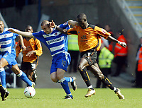 Photo. Chris Ratcliffe<br /> Reading v Wolverhampton Wanderers. Coca Cola Championship. 30/04/2005<br /> NIcky Forster of Reading goes away from Seyi Olofinjana of Wolves