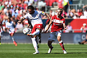 Danny Fox (4) of Nottingham Forset has close attention from Andreas Weimann (14) of Bristol City during the EFL Sky Bet Championship match between Bristol City and Nottingham Forest at Ashton Gate, Bristol, England on 4 August 2018. Picture by Graham Hunt.