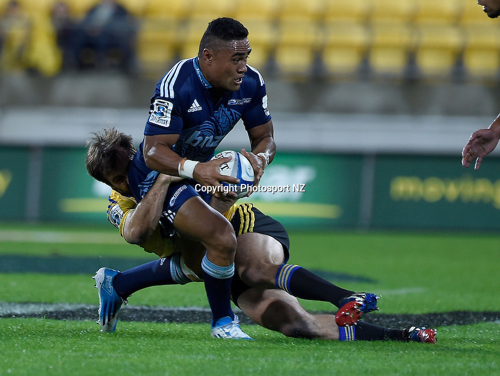 Francis Saili of the Blues is tackled by Conrad Smith captain of the Hurricanes during the Super Rugby - Hurricanes v Blues match at the Westpac Stadium in Wellington on Friday the 18th of April 2014.  Photo by Marty Melville/Photosport.co.nz
