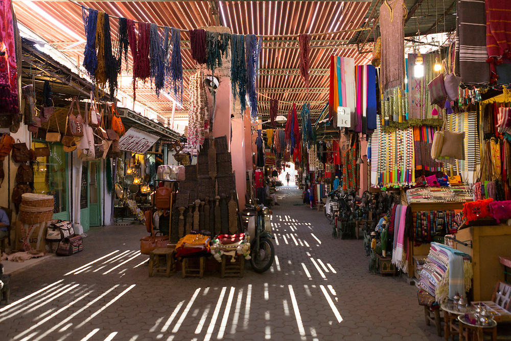 Dappled light from roofing in the covered market area of the dyers souk (souk des tenturiers), Marrakech Medina, Morocco