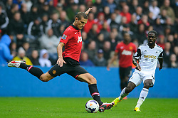 Man Utd Defender Nemanja Vidic (SRB) in action during the first half of the match - Photo mandatory by-line: Rogan Thomson/JMP - Tel: Mobile: 07966 386802 17/08/2013 - SPORT - FOOTBALL - Liberty Stadium, Swansea -  Swansea City V Manchester United - Barclays Premier League - First round of the 2013/14 season and the first league match for new Man Utd manager David Moyes.