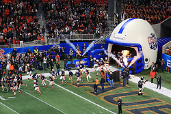 The Auburn Tigers run out of the tunnel prior to the 2018 Chick-fil-A Peach Bowl NCAA football game on Monday, January 1, 2018 in Atlanta. (Daniel Shirey / Abell Images for the Chick-fil-A Peach Bowl)
