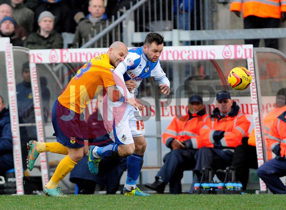 Oxford United's David Hunt fouls Bristol Rovers' Chris Beardsley  - Photo mandatory by-line: Dougie Allward/JMP - Tel: Mobile: 07966 386802 08/02/2014 - SPORT - FOOTBALL - Bristol - Memorial Stadium - Bristol Rovers v Oxford United - Sky Bet League Two