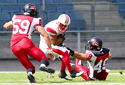 13.07.2011, UPC Arena, Graz, AUT, American Football WM 2011, Group B, Japan (JAP) vs Canada (CAN), im Bild Christian Houle (Canada, #59, LB) and Julien Hamel (Canada, #49, DB) tries to stop Takahiro Haruta (Japan, #84, TE)  // during the American Football World Championship 2011 Group B game, Japan vs Canada, at UPC Arena, Graz, 2011-07-13, EXPA Pictures © 2011, PhotoCredit: EXPA/ T. Haumer