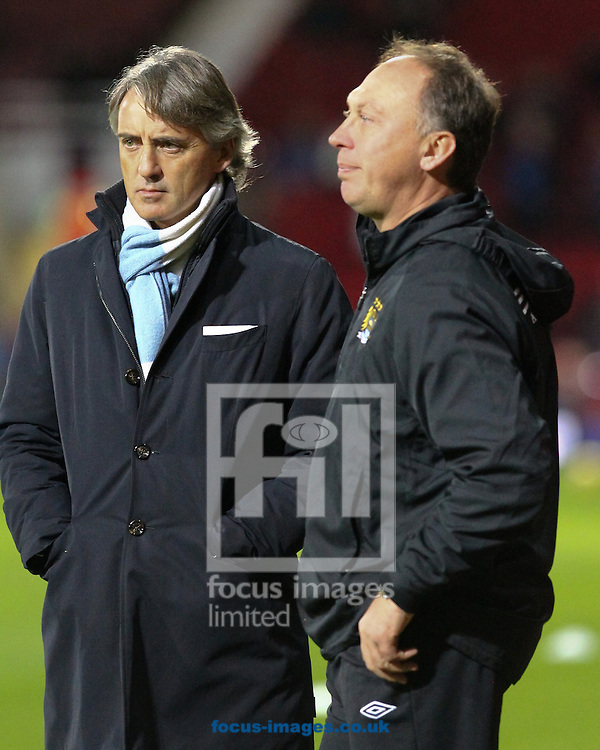 Picture by John  Rainford/Focus Images Ltd +44 7506 538356.03/11/2012.Roberto Mancini, manager of Manchester City watches the warm-up with his assistant David Platt before the Barclays Premier League match at the Boleyn Ground, London.