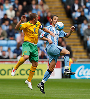 Photo: Richard Lane/Richard Lane Photography. Coventry City v Norwich City. Coca-Cola Championship. 09/08/2008. Coventry's Guillaume Beuzelin (rt) is challenged by Norwich's Mark Fotheringham.