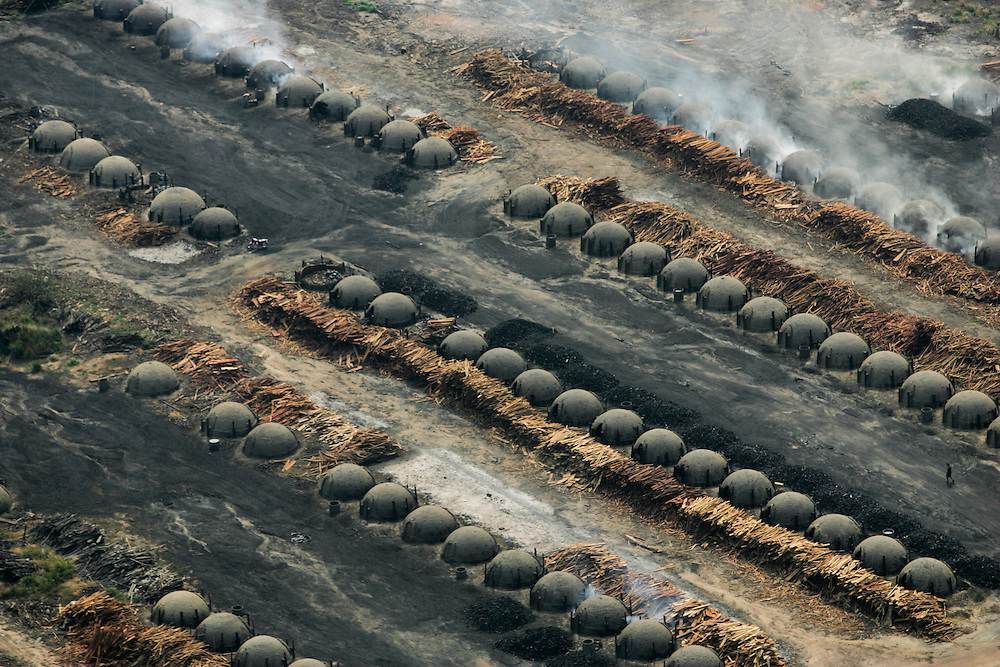 Aug. 21, 2005. Para State, Brazil. Rows of ovens used to produce charcoal out of rainforest wood. Forty percent of the timber extracted from the Amazon rainforest is used to produce charcoal for iron production. ©Daniel Beltra