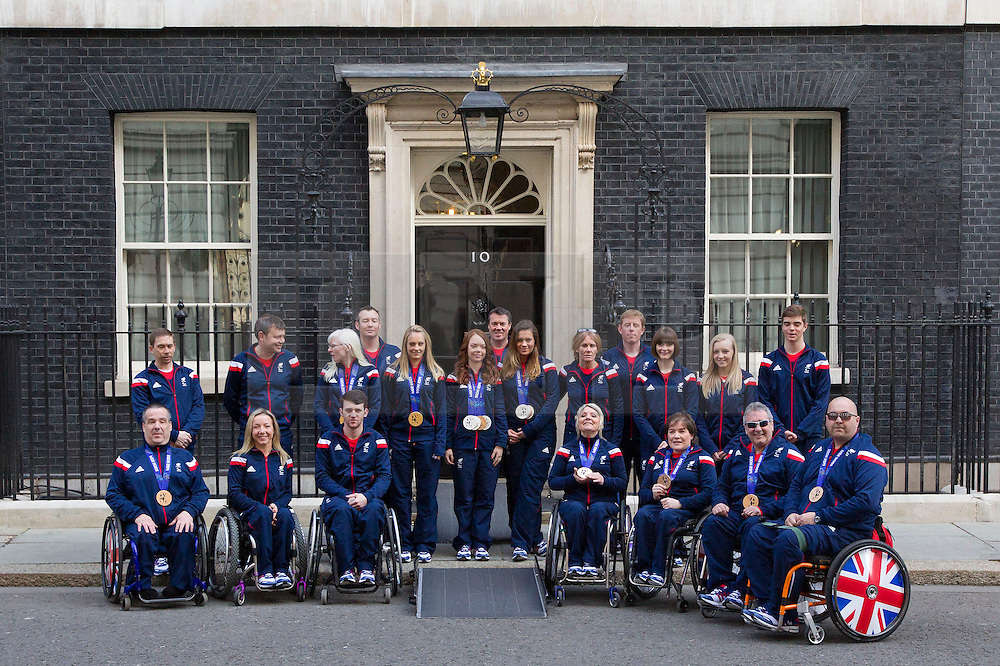 LNP Weekly Highlights 21/03/14 © Licensed to London News Pictures. 18/03/2014. London, UK. Members of the British Paralympic team pose outside Number 10 Downing Street during a visit to meet the British Prime Minister David Cameron. Photo credit: Matt Cetti-Roberts/LNP
