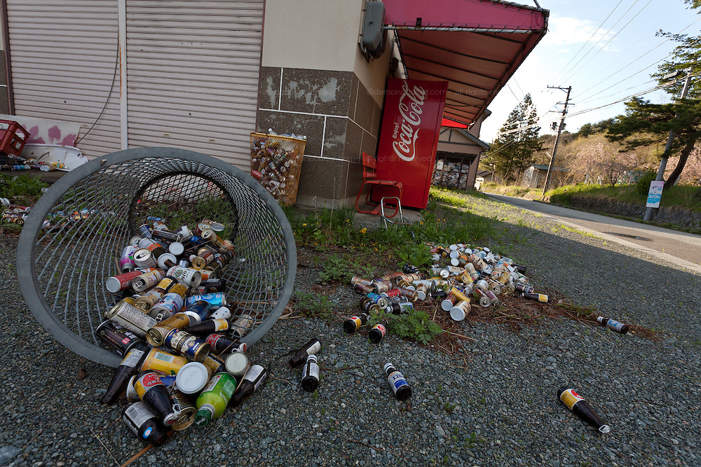 An empty shop with trash bins upturned and emptied by wild animals in the abandoned village of Tsushima in Fukushima, Japan. Friday May 4th 2012. After the explosions at the Daichi nuclear plant caused by the March 11th 2011 earthquake and tsunami, High levels of radioactive contamination in this village have made it uninhabitable.