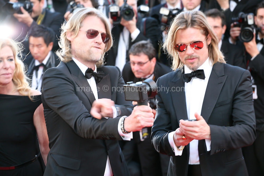 Director Andrew Dominik taking a 360 degree photograph with a spinner camera of the press  photographers and Actor Brad Pitt photographing with his phone at the Killing Them Softly gala screening at the 65th Cannes Film Festival France. Tuesday 22nd May 2012 in Cannes Film Festival, France.