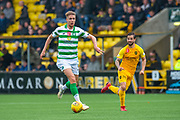 Kristoffer Ajer (#35) of Celtic FC runs past Keaghan Jacobs (#7) of Livingston FC during the Ladbrokes Scottish Premiership match between Livingston FC and Celtic FC at The Tony Macaroni Arena, Livingston, Scotland on 6 October 2019.