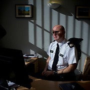 BELFAST, NORTHERN IRELAND - SEPTEMBER 29, 2016: Assistant Chief Constable Mark Hamilton, the UK's National Police Chiefs' Council Lead for Hate Crime, at his office in the Police Service of Northern Ireland (PSNI) headquarters in Belfast. Due to the nature of his job, the Constable's bunkerlike office is located in a secluded area of the highly secured PSNI's compound in the east area of Northern Ireland's capital city. CREDIT: Paulo Nunes dos Santos for The New York Times