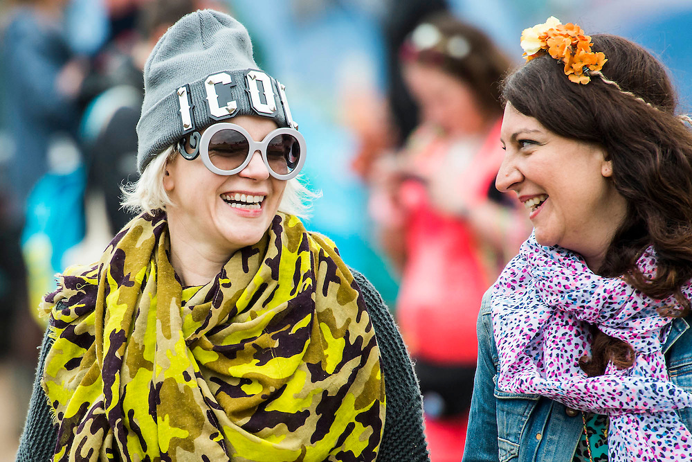 Happy visitors watching bands. The 2015 Glastonbury Festival, Worthy Farm, Glastonbury.