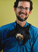 Gary Wiles, U.S. Department of Agriculture and Wildlife Resources with a Mariana fruit bat clinging to his shirt. The Mariana fruit bat - a medium-sized bat found only in Guam and the Commonwealth of.the Northern Mariana Islands (CNMI) - has been reclassified from endangered to threatened status on Guam and newly listed as threatened in the CNMI (as of 2005).  (MODEL RELEASED).