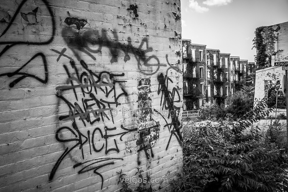 Cincinnati abandoned buildings graffiti at the Glencoe-Auburn Place Complex. The Glencoe-Auburn Hotel and Glencoe-Auburn Place Row Houses were built in the late 1800's and are listed on the U.S. National Register of Historic Places. The complex is currently abandoned and in extremely poor condition. Photo is high resolution black and white.