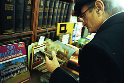 BUENOS AIRES, ARGENTINA:  A man flips through literature while shopping at a book store in Buenos Aires, Argentina. (Photo by Ami Vitale)