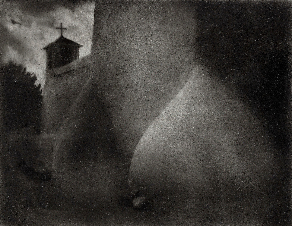 The San Francisco de Assissi Mission Church in Ranchos de Taos, New Mexico is an adobe building with heavy mud buttresses. This image was created using the Bromoil process.