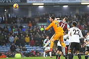 11 Chris Wood for Burnley FC wins the header on goal from Fulham goalkeeper Sergio Rico (25) during the Premier League match between Burnley and Fulham at Turf Moor, Burnley, England on 12 January 2019.