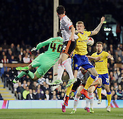 Scarmble in the Fulham penalty area during the Sky Bet Championship match between Fulham and Wigan Athletic at Craven Cottage, London, England on 10 April 2015. Photo by Matthew Redman.
