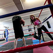 Boxing and sparring rounds at Sweet Z's Boxing Gym in Kansas City, Kansas.