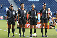 16 October 2014: Match officials. From left: Assistant referee Eperatriz Ayala (SLV), Fourth official Mirian Leon (SLV), Referee Melissa Borjas (HON), and Assistant referee Shirley Perello (HON). The Jamaica Women's National Team played the Martinique Women's National Team at Sporting Park in Kansas City, Kansas in a 2014 CONCACAF Women's Championship Group B game, which serves as a qualifying tournament for the 2015 FIFA Women's World Cup in Canada. Jamaica won the game 6-0.
