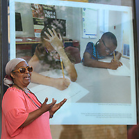 Zell Long, Chief Professional Officer of Boys & Girls Club of North MS;, talks about her Boys and Girls Club themed photograph after unveiling it Thursday morning at Renasant Bank in downtown Tupelo. The photo's also include a QR code that plays a video. Each participant used an iPhone 7 Plus and was tasked with choosing an aspect of the community and telling its story. The interactive street side photo gallery displayed are stories told from the perspective of eight Tupelo residents and was led by Blue Magnolia Films.