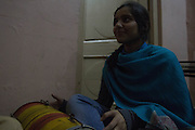 11 December 2013. Sialkot, Pakistan. Amna Liaquat plays a drum in celebration of her cousin's wedding who will be moving to the US after her wedding. Photo by Sehar Mughal/NYCity Photo Wire